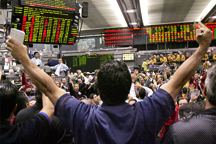 Equity traders crowd the S&P 500 Futures pit Tuesday, April 25, 2006, at the Chicago Mercantile Exchange. Chicago Mercantile Exchange Holdings Inc., which owns the Mercantile Exchange, said Tuesday that rising volumes for futures contracts boosted first-quarter net income by 29 percent:  Those results fell short of Wall Street's expectations, and the company's average rate per contract, an important measure of profit margin, slipped modestly. (AP Photo/Charles Rex Arbogast)