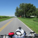 Northbound_on_County_Road_16_in_Clinton_Township,_Fulton_County_-_rural_scenery_of_corn_fields_and_farmstead